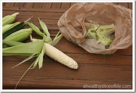 shucking corn outside