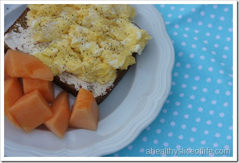scrambled eggs on toast and cantaloupe