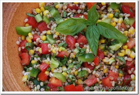 summer vegetable and barley salad close up