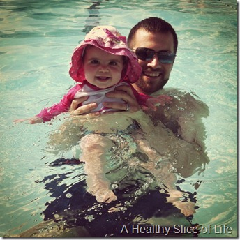 Hailey 10 months- pool with dad