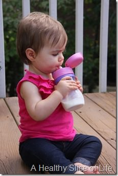 introducing baby to cow's milk- taking a sip