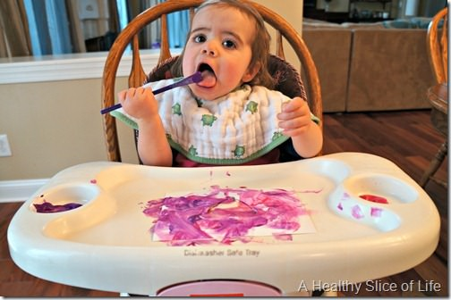toddler valentine art- eating paint