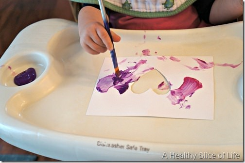 toddler valentine art- painting in high chair