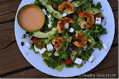 Spicy Shrimp Salad. Romaine, black beans, onion, tomatoes, feta ...