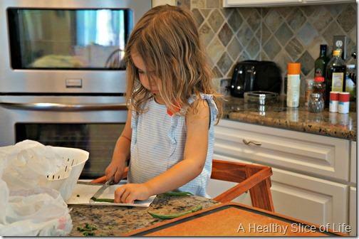 toddler trimming green beans