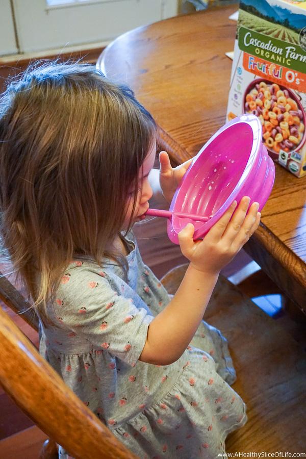 toddler drinking cereal milk
