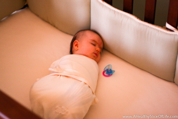 baby swaddled in crib