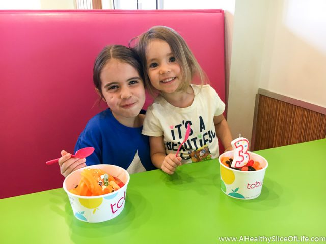 sisters eating froyo