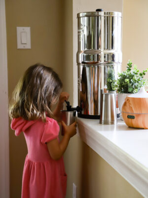 girl using a Berkey water filter
